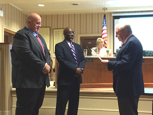 During this week's Mayor and Council meeting, Berlin Mayor Gee Williams performed a swearing-in ceremony for new Berlin Councilman Thom Gulyas and incumbent Councilman Dean Burrell. Gulyas will replace Paula Lynch on the council as the at-large representative after being the lone candidate to file for the seat. Burrell was unopposed for his next term. Photo by Charlene Sharpe