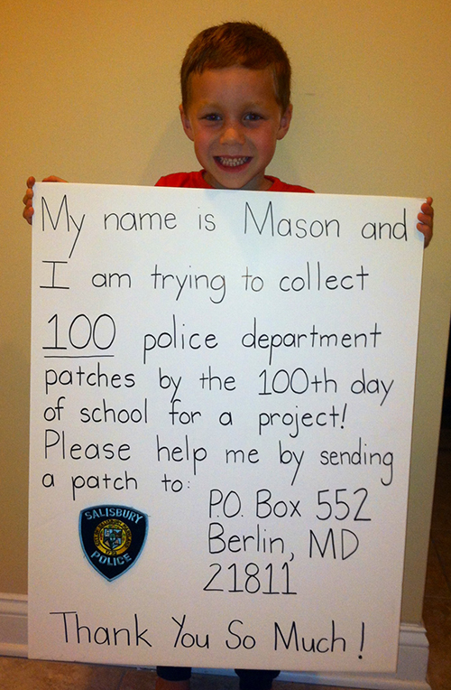 Five-year-old Mason Hetherington's goal of collecting 100 police agency patches by the 100th day of school received a major boost when deputies from the Worcester County Sheriff's Office surprised him last weekend. Submitted Photo