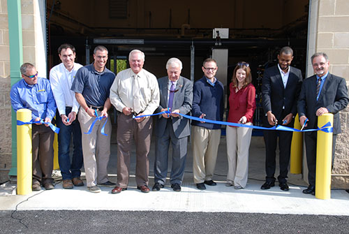 Federal, state and county officials are pictured Tuesday cutting a ceremonial ribbon on the new wastewater treatment plant located within the Mystic Harbour community off Route 611. Photo by Shawn Soper