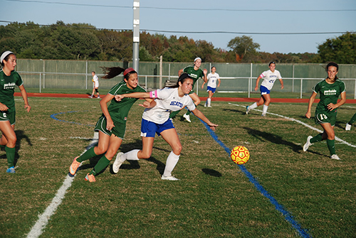 Decatur's Payton VanKirk battles for the ball with Parkside defenders during the second half of the Bayside South clinching win over the Rams on Tuesday.  Photo by Shawn Soper