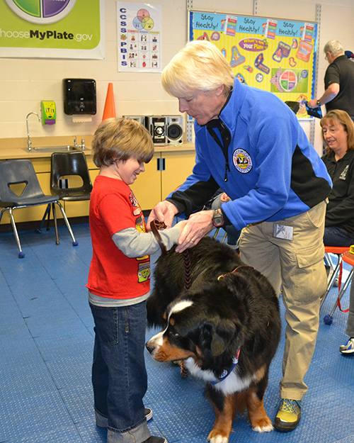 Wicomico Wagsters member Welton Seal works with Cedar Chapel Special School student Xander Jahn and Murphy, his Bernese Mountain Dog, last Friday. Photos by Charlene Sharpe