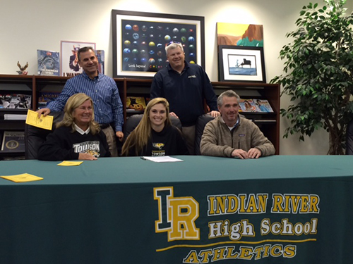 Indian River's Maggie Allison (seated center) this week signed a national letter of intent to play Division I lacrosse at Towson University after an eight-year career with the Ocean City-based Sea Bay Lacrosse Club. Pictured with Maggie are her parents, Kim and Jamie Allison, along with Sea Bay coaches Fred Yesko and Malcolm Van Kirk.  Submitted photo