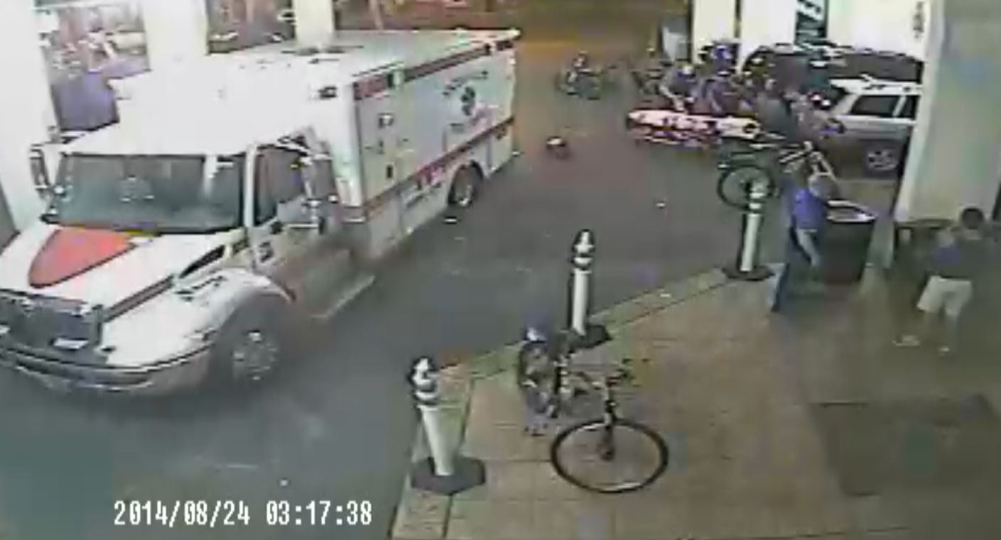 A screenshot of the Plim Plaza Hotel's surveillance video shows emergency responders tending to Justin Cancelliere.