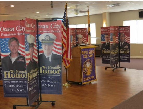The Ocean City Mayor and Council unanimously supported the return next summer of the Hometown Heroes Military Banner Program. Some of the banners are shown above at a recent Ocean City Elks Lodge ceremony where they were presented to family members. Submitted Photo