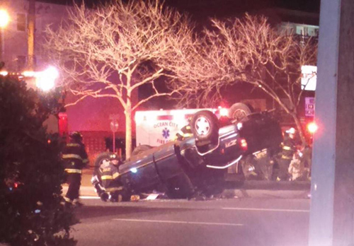 The GMC pick-up truck that flipped after striking another vehicle is pictured on Saturday night. Staff Photo