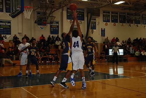 Decatur's Keve Aluma goes up for a rebound against Pocomoke during the second quarter on Tuesday. Pocomoke rolled past the Seahawks, 74-40, to remain unbeaten.  Photo by Shawn Soper