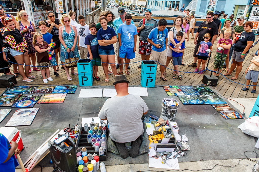 Spray paint artist Mark Chase, who would like to serve on the new Boardwalk Regulation Task Force, is pictured on the Boardwalk last summer. Photo by Chris Parypa