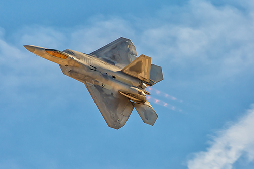A F-22 Raptor is pictured in action at a previous air show held at Nellis Air Force Base in Nevada. Photo by Chris Parypa