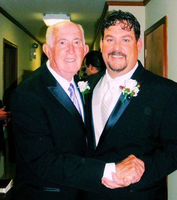 Crabcake Factory owner John Brooks, right, is pictured with his father, Ron Brooks. File Photo