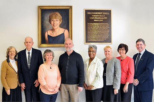 Family and friends of the late Lois E. Brunkhorst of Berlin, from left, are Brunkhorst's sister and brother-in-law, Joyce and William Walton of Morganton, N.C., with Georgina and Dan Cathell of Berlin, Gladys Gaynor of Berlin, Dione Shaw of Willards, Janice Murphy of Salisbury, director of development at Wor-Wic Community College, and Dr. Ray Hoy, Wor-Wic president.