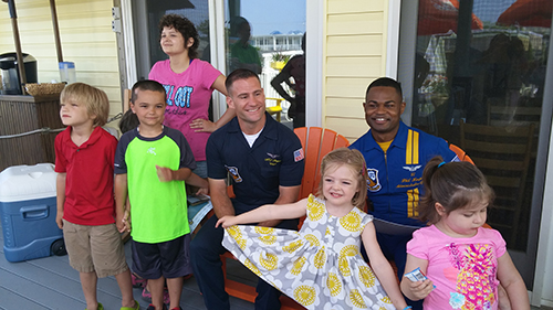 During some down time last Friday morning, two members of the U.S. Navy Blue Angels stopped by the Believe in Tomorrow Children's House by the Sea to spend time with families staying in the facility. Photos by Joanne Shriner