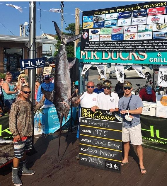 """""""Sea Prowler"""" crew member Jason McFadden, right with arm in a sling, was able to join his mates at the docks of the Talbot Street Marina to weigh-in a big swordfish."""