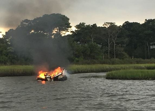 A rented pontoon boat is pictured engulfed in flames in Sinepuxent Bay on Monday afternoon. Photo by NRP