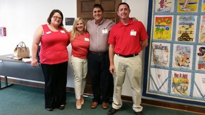 Wearing red at City Hall to show opposition to a proposed new zoning district in Ocean City were, from left, Sarah Rayne, Government and Public Affairs Director for Coastal Association of REALTORS® (CAR); Jamie Wetzelberger, CAR Government Affairs Committee Chair; Joe Wilson, member of the CAR Board of Directors and CAR RPAC Committee Chair; and Chris Mitchell of Coldwell Banker Vacations. Submitted Photo
