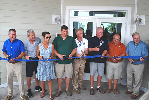 Among those attending Tuesday's ribbon cutting ceremony for the new Ocean City Beach Patrol headquarters were, from left, City Engineer Terry McGean, OCDC President Glenn Irwin, Council members Mary Knight and Wayne Hartman, OCBP Captain Butch Arbin, Mayor Rick Meehan and Council members Dennis Dare and Doug Cymek. Photos by Shawn Soper