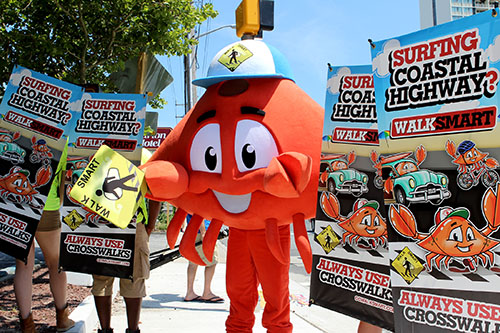 "The OC Walk Smart campaign mascot ""Crab the Lifeguard"" is pictured with some volunteers displaying some of the marketing materials that are being featured in town. Photo by Joanne Shriner"