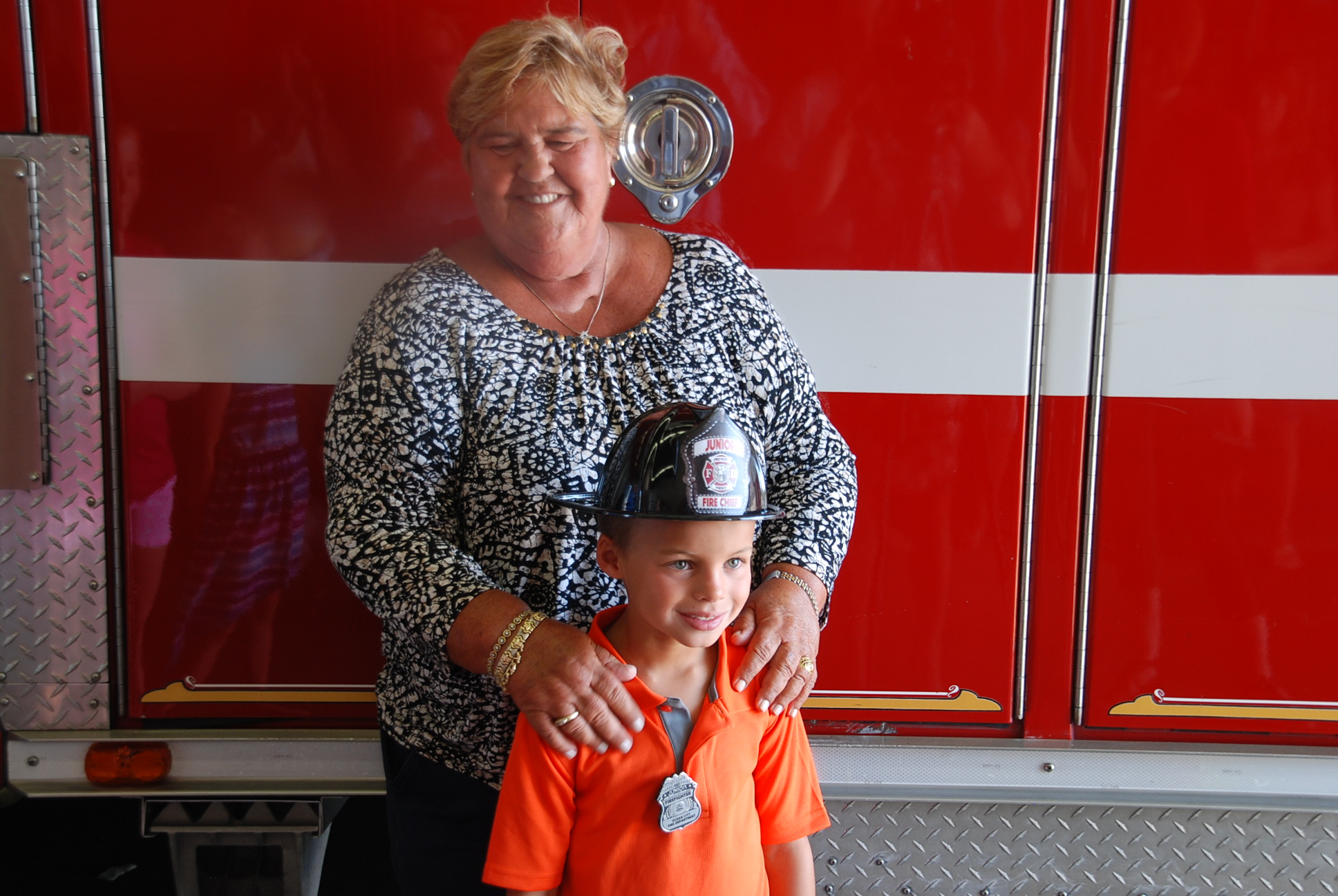 Mason Farr, 7, is pictured with his aunt, Jenny, at this morning's event honoring his heroic actions in May. Photo by Shawn Soper