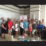 Realtors with Mark Fritschle Group-Condominium Realty are pictured at a recent sales meeting where July leaders were announced. Submitted Photos