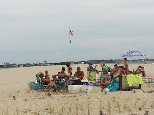 Recreational boaters over the summer have been routinely enjoying days on Dog and Bitch Island, which is home to a flag erected in late June. Photo courtesy of Keepers of the Flag Facebook page
