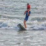 A volunteers with Surfers Healing got creative with showing this young girl the joy of surfing.