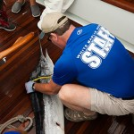 """Dockhand Mike Hannon measures what would be the second-place white marlin in this year's event onboard the """"Lights Out."""" Photos by Hooked On OC"""