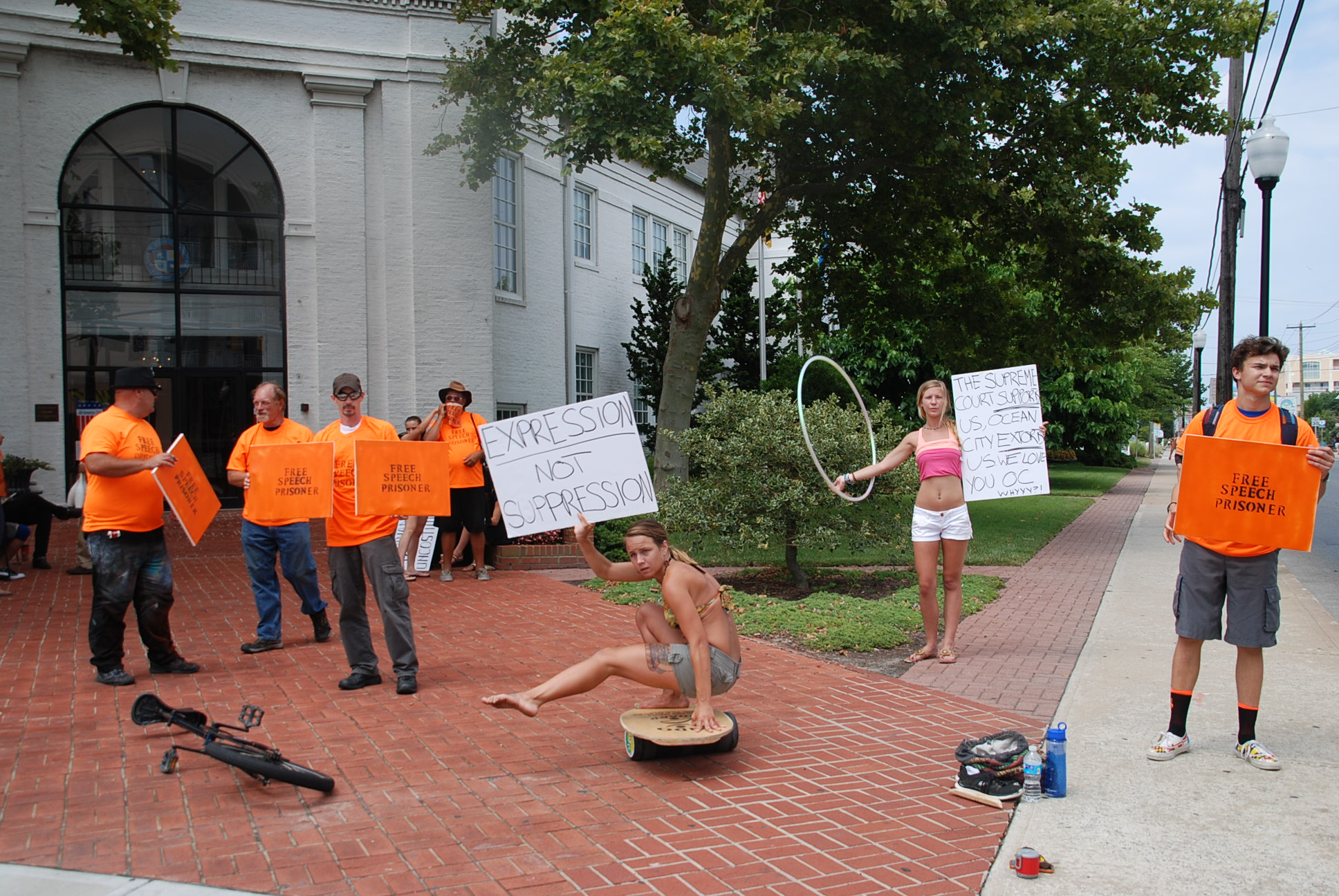Street performers are shown protesting outside of City Hall last month. Photo by Joanne Shriner