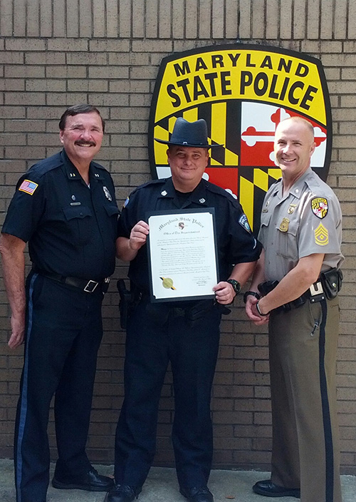 Ocean Pines Police Patrolman First Class James D. Minton is pictured with Chief David Massey and Assistant Barrack Commander First-Sergeant Christopher Davala. Submitted Photo