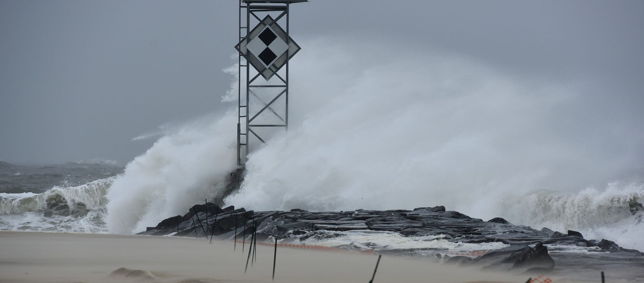 Waves are pictured crashing on the Inlet jetty Thursday morning. Photo by Allen Sklar