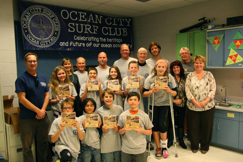 "Members of the Ocean City Surf Club are pictured with the students who completed the ""Surfing Into Integrity"" after-school program at Stephen Decatur Middle School. Photos courtesy of Ocean City Surf Club"