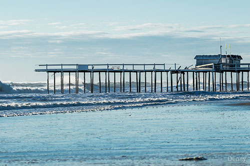 For the third time in five years, the iconic Ocean City fishing pier suffered severe damage during last weekend's storm as waves nearly as high as the structure itself smashed support pilings. Already plans are underway to restore the historic pier.  Photo by Nick Denny