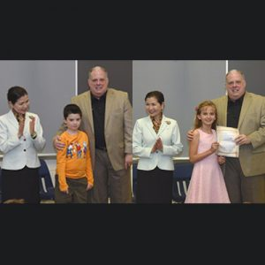 Gov. Larry Hogan and his wife, Yumi, are pictured with Ocean City Elementary School third grader Lucas Magathan, above left, who has battled leukemia this school year, and Savannah Palmisano, who wrote the governor requesting he visit the school. Photos by Bryan Russo