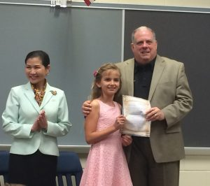 Gov. Larry Hogan and his wife, Yumi, are pictured with Ocean City Elementary School third grader Savannah Palmisano at the school this morning. It was Palmisano's letter that brought him for the morning visit. Photo by Bryan Russo