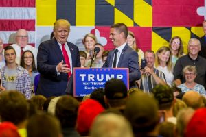 Trump Campaign Senior Advance Kevin Chmielewski is pictured on stage with Trump. Photo by Chris Parypa
