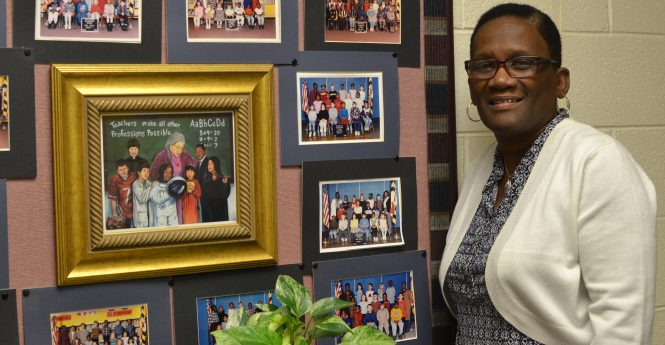 Buckingham Elementary Assistant Principal Terry Smith has a collection in her office of all her former classes she led as a first-grade teacher.  Photo by Charlene Sharpe