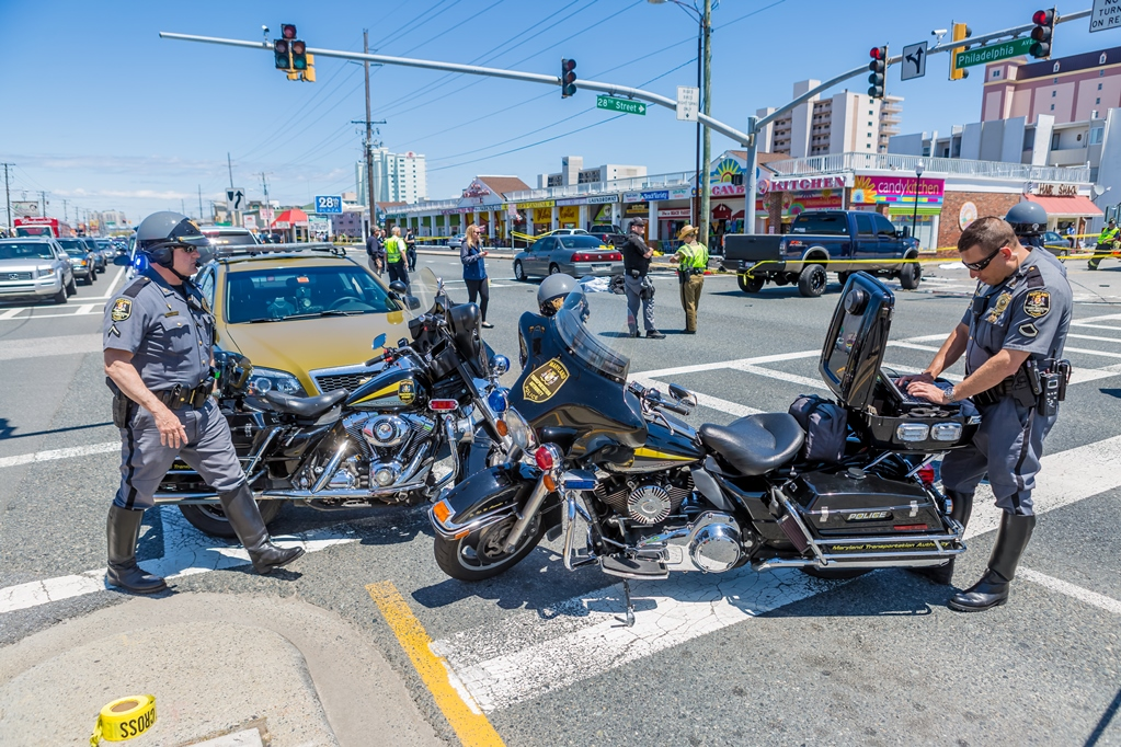 Law enforcement members are pictured on the scene of the fatal accident on 28th Street last Thursday, May 19. Photo by Chris Parypa