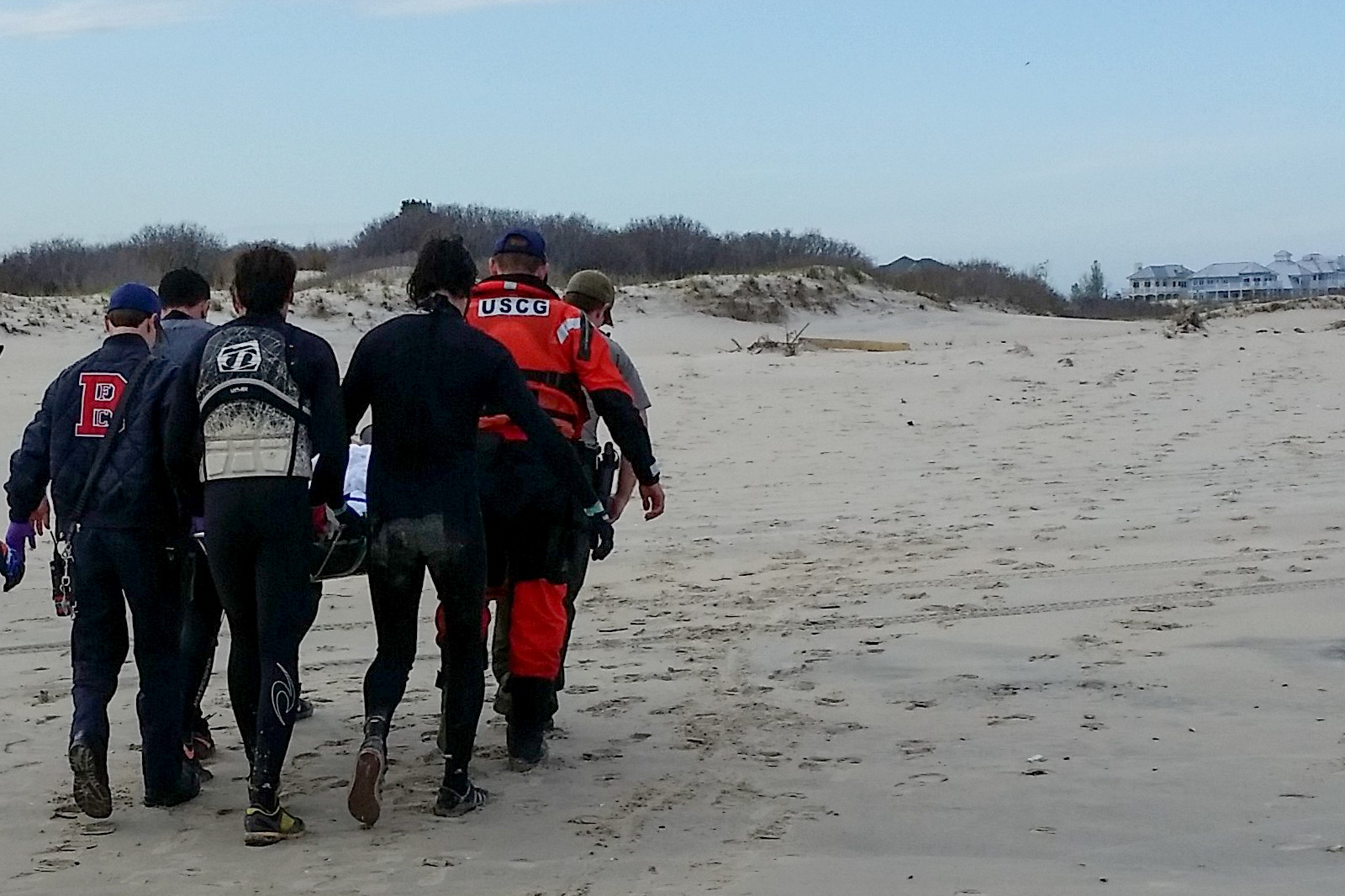 Crewmembers from Coast Guard Station Ocean City, Md., local emergency medical personnel, and friends carry an injured man from the north end of Assateague Island National Seashore to a Coast Guard 24-foot Special Purpose Craft-Shallow Water Saturday, April 30, 2016, for transport to Atlantic General Hospital. The SPC-SW crew was on patrol when friends of the injured man stopped the crew to state their friend had suffered a broken leg, was stranded, and in need of assistance. U.S. Coast Guard photo by Petty Officer 2nd Class Kyle Wood