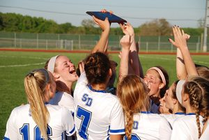Stephen Decatur's girls' varsity lacrosse team was all smiles after winning their third straight regional title on Wednesday and returning to the state's Final Four. Pictured above, the Seahawks hoist the state region championship plaque following the decisive win.   Photo by Shawn Soper