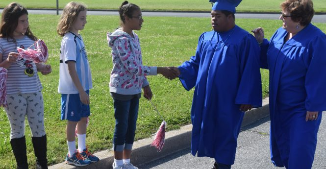 Hunter Schoolfield takes a ceremonial lap around Cedar Chapel Special School in advance of next week's graduation. Photo by Bryan Russo