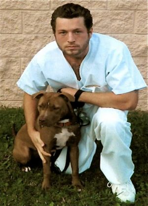 Chase Fehrenbach was sentenced to 21 years in prison in 2008 for armed robbery , theft and burglary, crimes he said he committed to fund his heroin addiction. He is pictured with a dog he helped rehabilitate through his prisons outreach Paws fora  Cause Program.