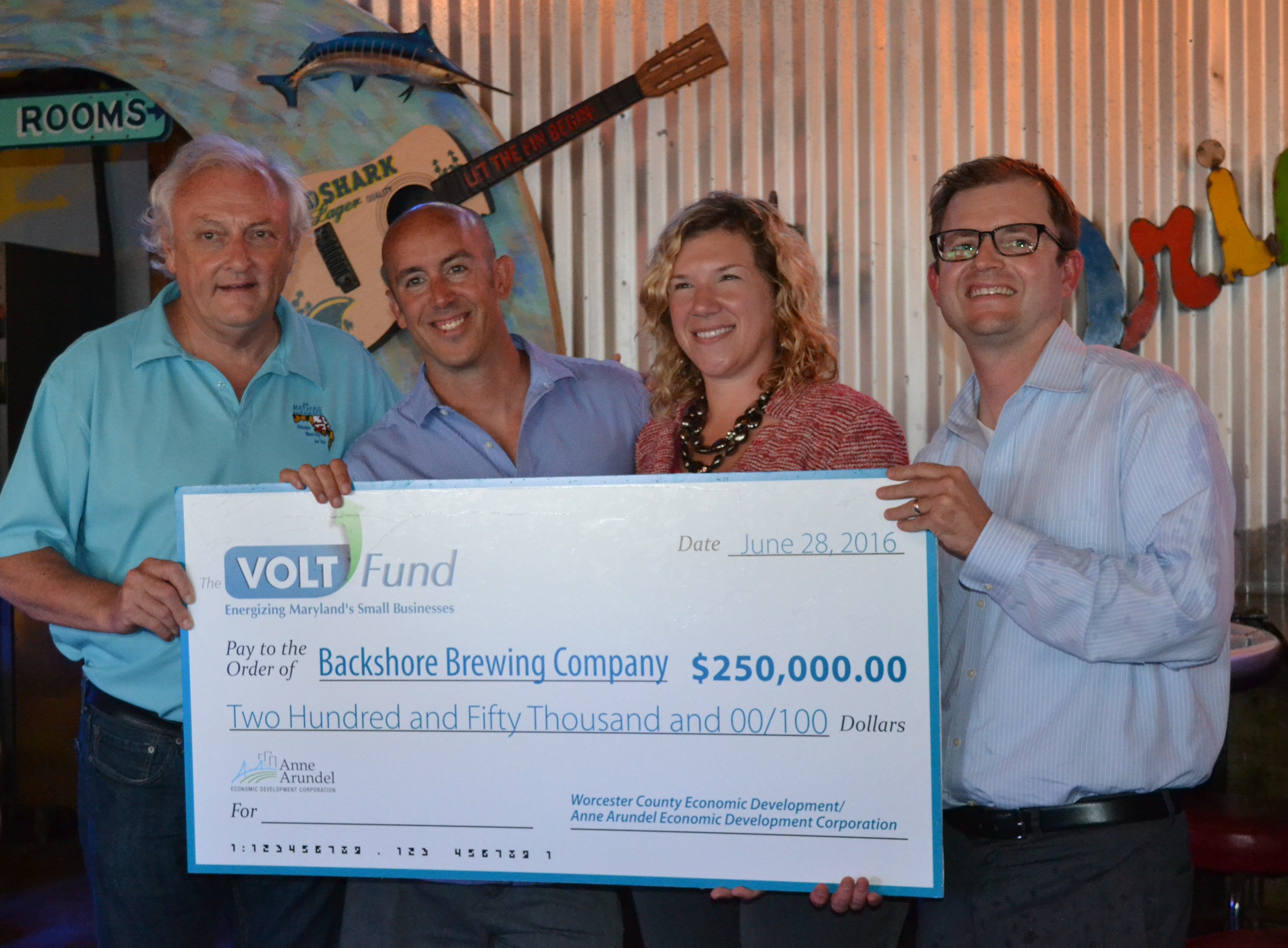 Pictured, from left, at Tuesday's check presentation to Backshore Brewing were Senator Jim Mathias, owner Danny Robinson, Worcester County Economic Development Director Merry Mears and Stephen Primosch from the Anne Arundel County Economic Development office. Photo by Charlene Sharpe