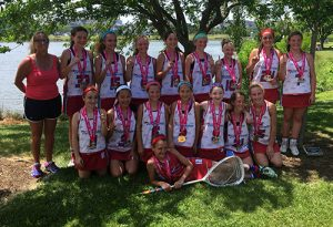 The local Delmarva Dolphins under-13 girls' lacrosse team last week went undefeated to win the Brine Girls Lacrosse Festival in Ocean City. Pictured above, the happy crew shows off their championship medals.  Submitted photo