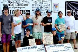 The competitors were all smiles after the Walk Da Plank Pro Longboard Challenge last Sunday. Pictured above, from left are Ocean City Surf Club President Wyatt Harrison, Colbie Crombie, Kevin Penn, Roland Gerachis, Thomas Cannon, Chris Makibbin and Contest Director Chris Tilghman. Pictured in front are second-place winner Brier Haycox and first-place winner Tony Silvagni. Not pictured is Mike Melchiorre.  Photo courtesy Plak That Printing Co.