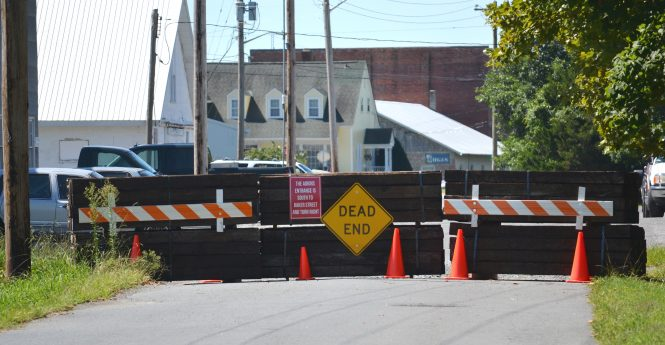 The barricade set up by the Adkins Company along Harrison Avenue is pictured Wednesday. Photo by Charlene Sharpe