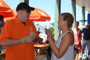 Hogan speaks with Madison Friz, 16, at the Children's House by the Sea last Friday. Photo by Charlene Sharpe