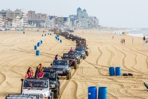 One of the highlights of the annual Jeep Week is the daily beach crawls in Ocean City. Photo by Chris Parypa