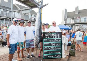 By virtue of her 94-pound beauty, Cheryl McLeskey, center, made White Marlin Open history last year becoming the first female angler to capture the tourney's top honor. Photo by Hooked On OC