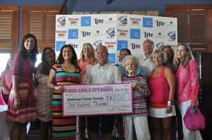 The 23rd Annual Poor Girls Open was once again a big success with thousands of dollars in prize money doled out to the winners in some categories and more importantly, a $100,000 check to the American Cancer Society. Pictured above, tournament director Shawn Harman presents the big check to the happy recipients during the awards ceremony.  Submitted photo
