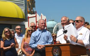 Gov. Larry Hogan holds up the Executive Order he signed in August setting the school  year calendars for Maryland public schools. Photo by Charlene Sharpe