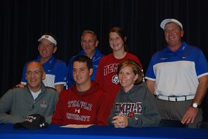 Decatur's Matt Kristick has signed a letter of intent to continue his athletic and academic career at Temple University in Philadelphia. Pictured above is Kristick (center) with his family and coaches.  Photo by Shawn Soper