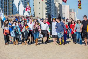 Bull on the Beach owner Phil Houck, center, leads his team from his restaurant on 94th Street to the beach for last weekend's Penguin Swim. Once again the Bull team raised an impressive $31,215 for Atlantic General Hospital.